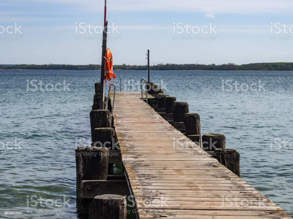 Boat landing stage with rescue ring and rescue pole 1 - Royalty-free Accidents and Disasters Stock Photo