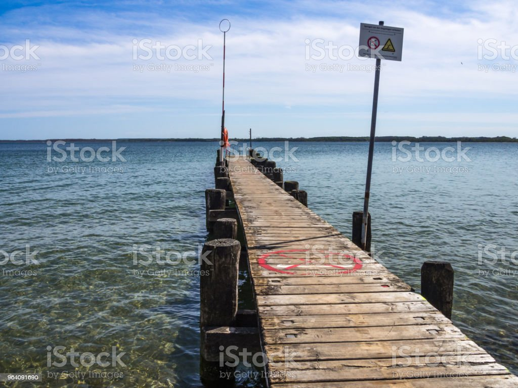Boat landing stage with rescue ring and rescue pole2 - Royalty-free Accidents and Disasters Stock Photo