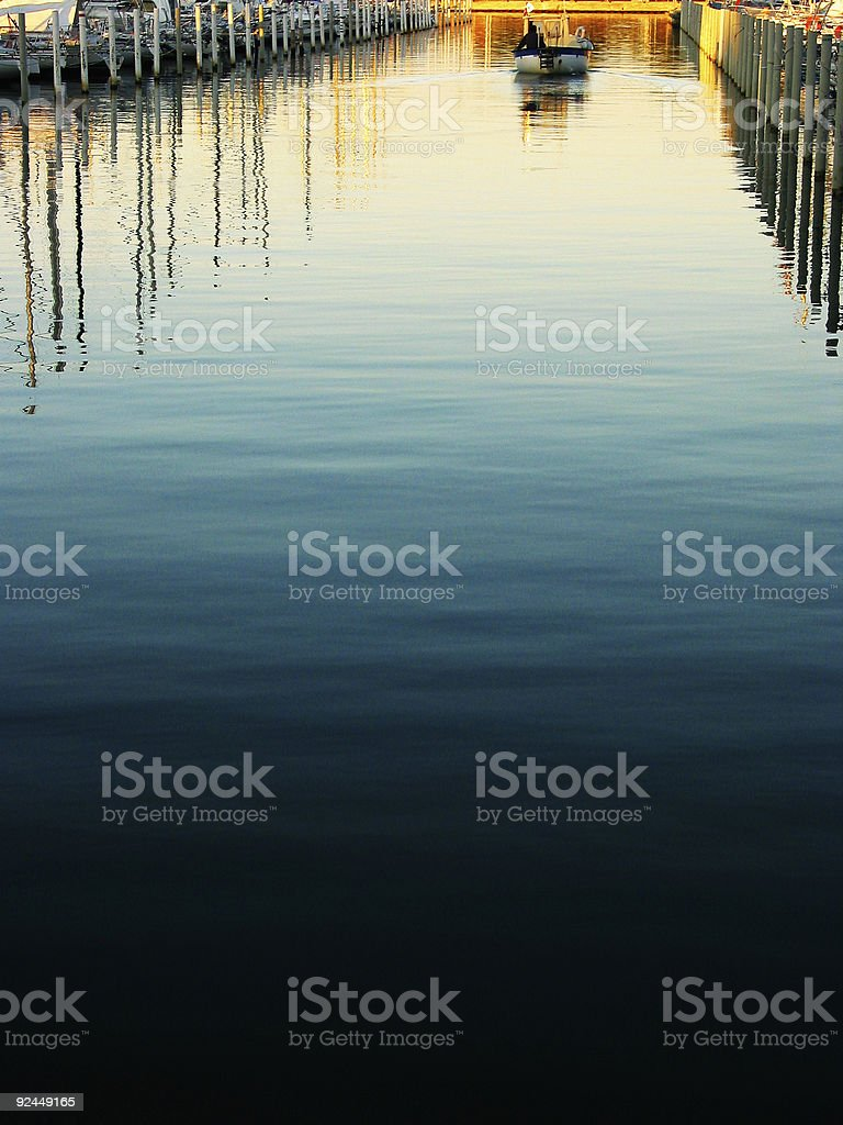 boat leaving the port royalty-free stock photo