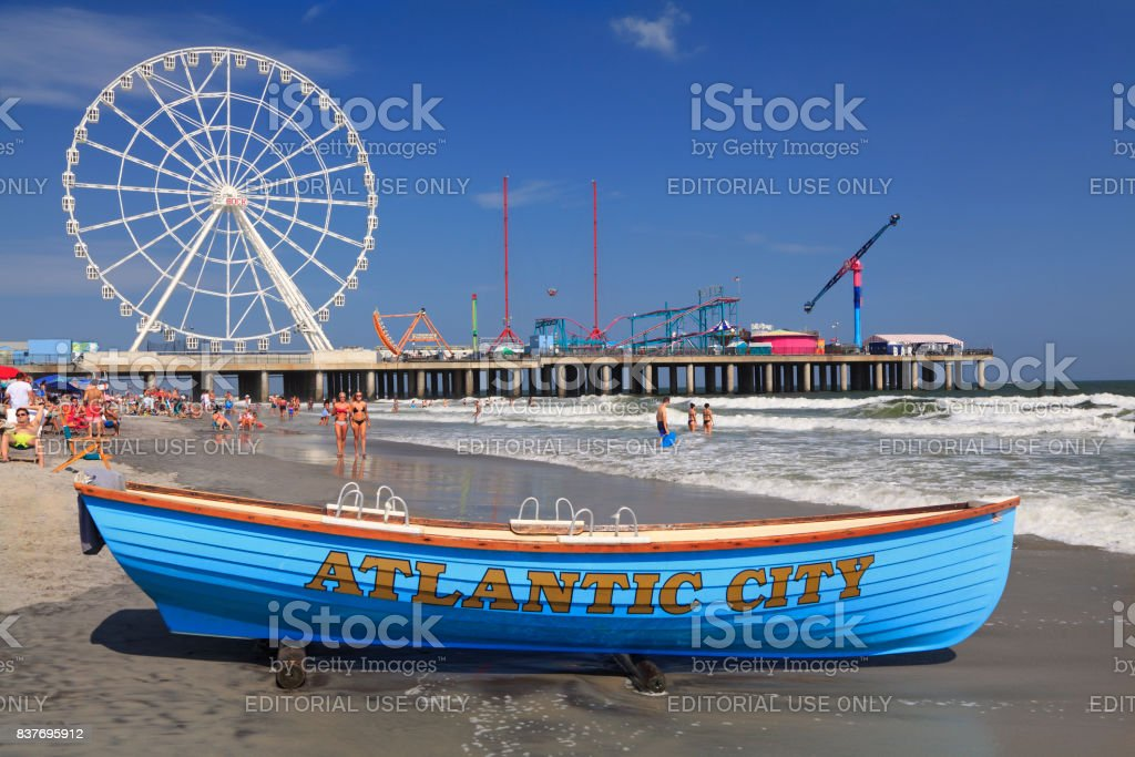 Boat lifeguard, beach and steel Pier in Atlantic City, New Jersey stock photo