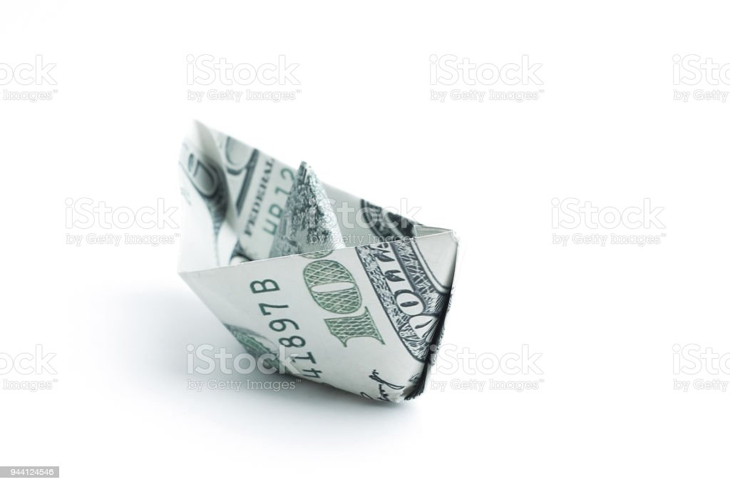 boat made origami from dollar bills.isolated on a white backgro boat made origami from dollar bills.isolated on a white background.photo with copy space Belarus Stock Photo