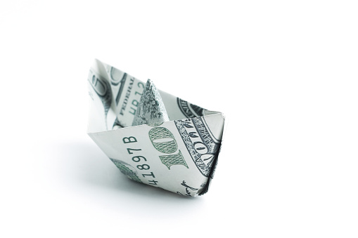 Boat Made Origami From Dollar Billsisolated On A White Backgro Stock Photo - Download Image Now