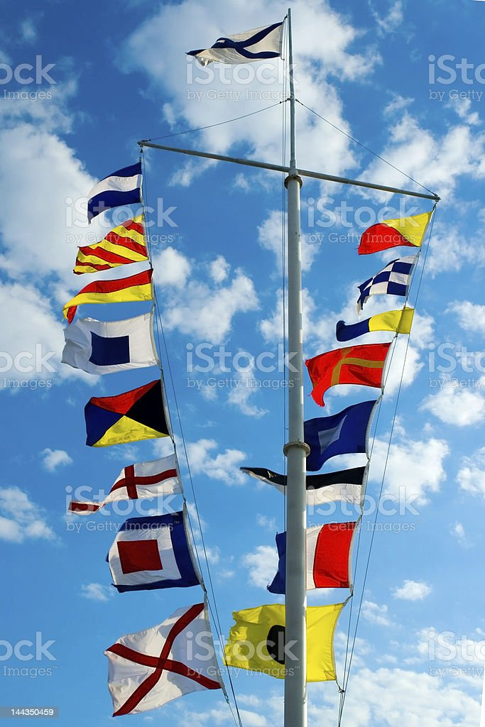 Boat mast with colorful signal flags stock photo