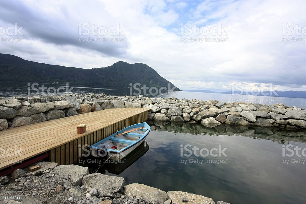 Boat moored at pier royalty-free stock photo