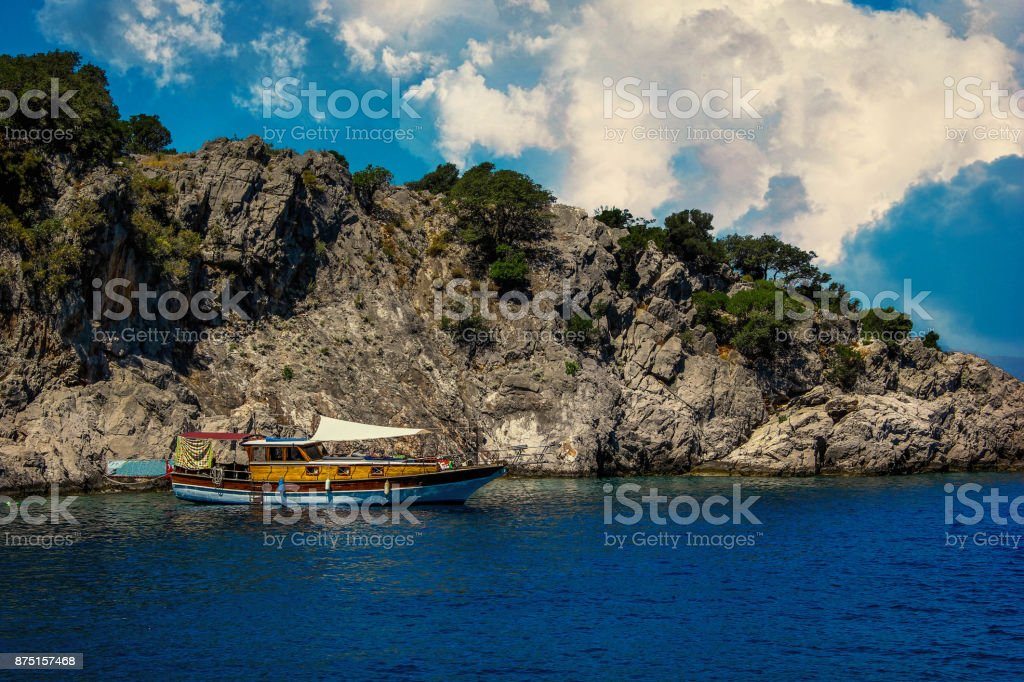 Boat moored in the bay on a cloudy day stock photo