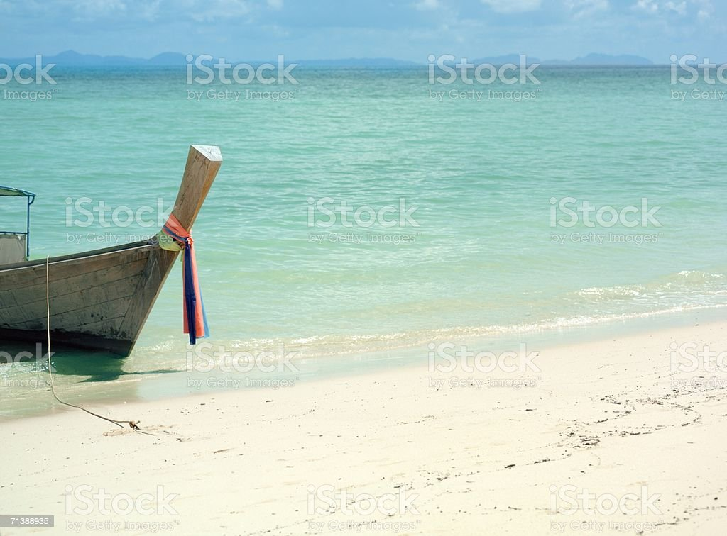 Boat moored to a beach royalty-free stock photo