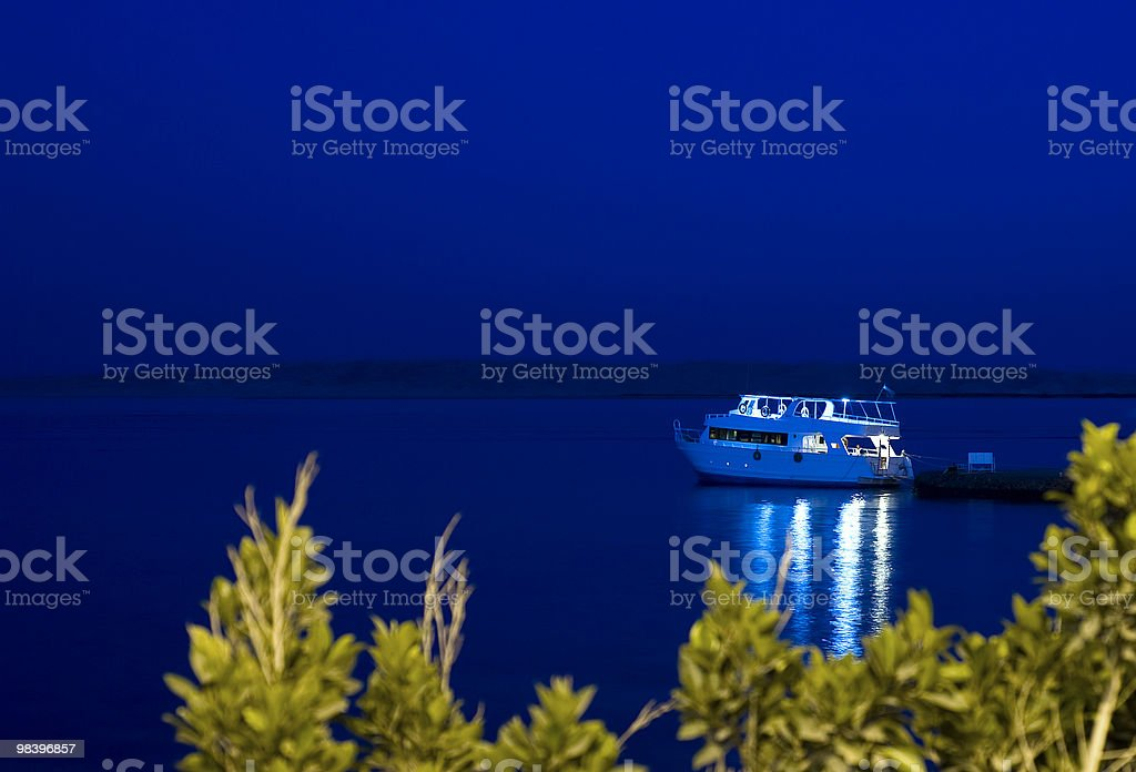 Boat moored to jetty at night royalty-free stock photo