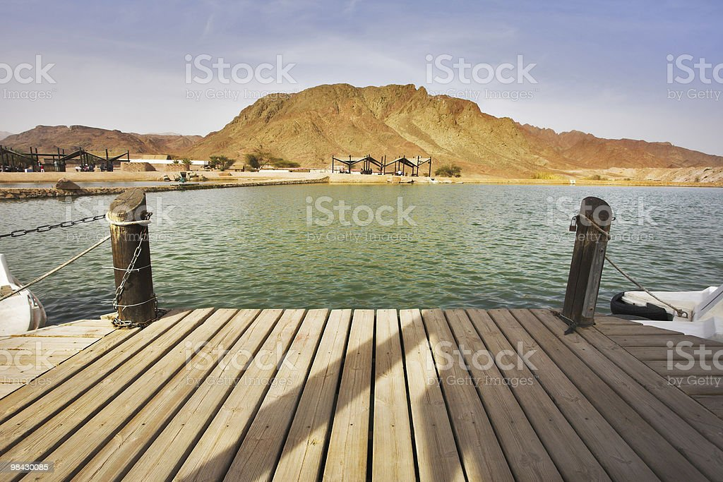 Boat mooring and small lake in  park Timna royalty-free stock photo