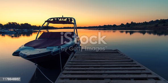 Boat near a pier at sunrise