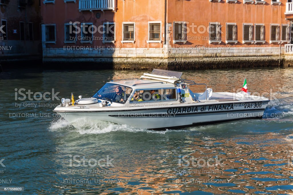 boat of the Guardia di Finanza on Grand Canal in Venice, Italy royalty-free stock photo