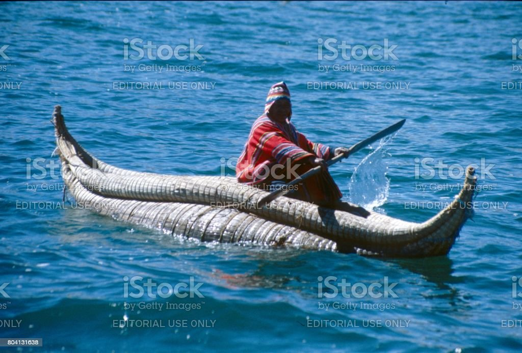 Boat of Urus from Totora reeds on Lake Titicaca stock photo
