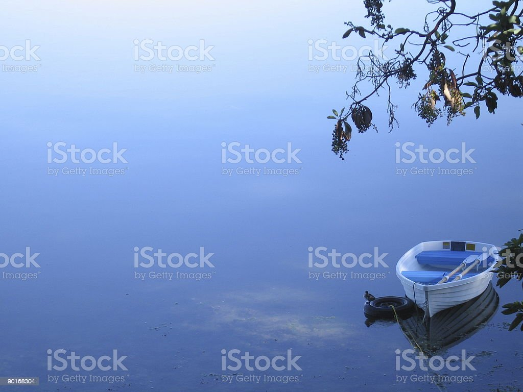 Boat on a Calm Lake royalty-free stock photo
