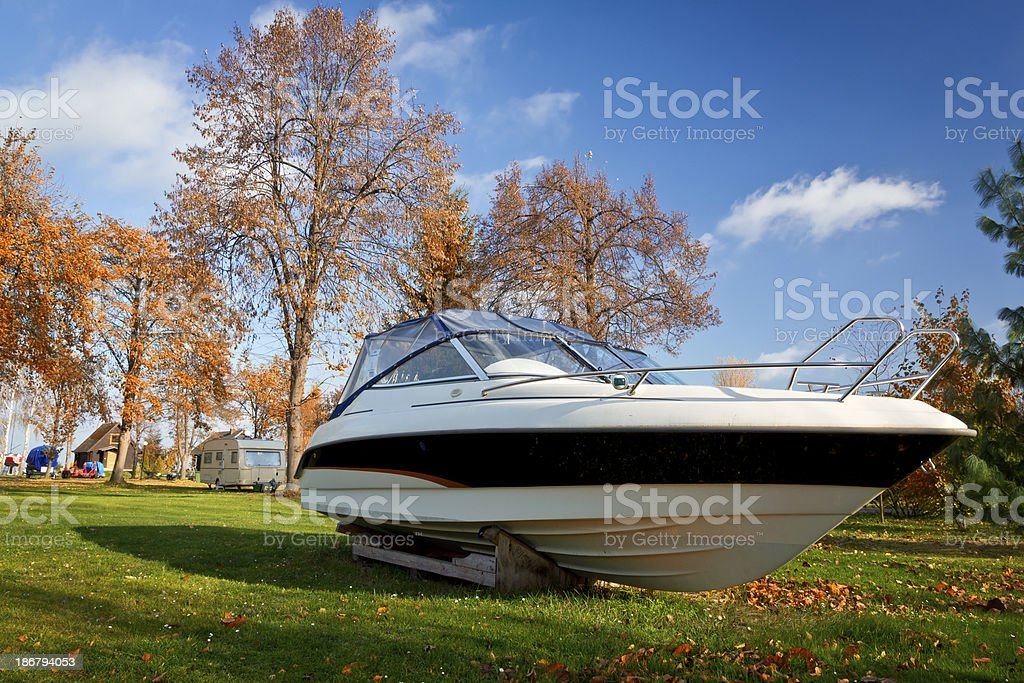 Boat on a green lawn in the Marina stock photo