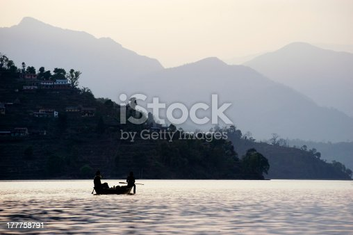 184332102istockphoto boat on a lake in the mountains 177758791