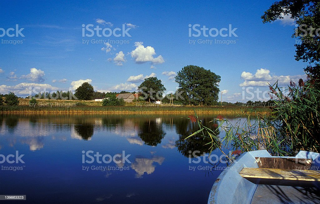 boat on a masurien lake royalty-free stock photo