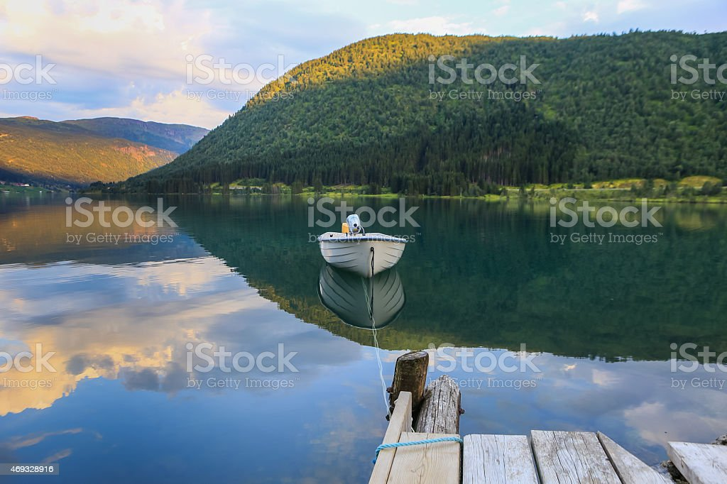 Boat on a mirror stock photo