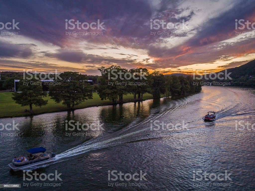 Boat on a Sunset Lake in Austin, Texas royalty-free stock photo