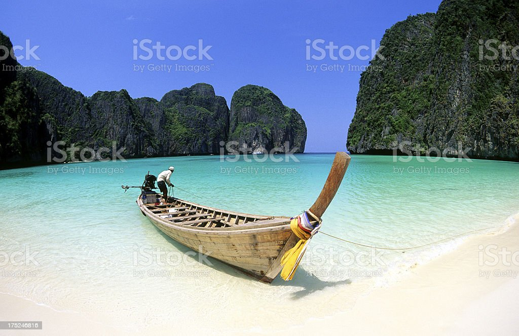 A boat on a Thai beach in Maya Bay, Krabi province stock photo