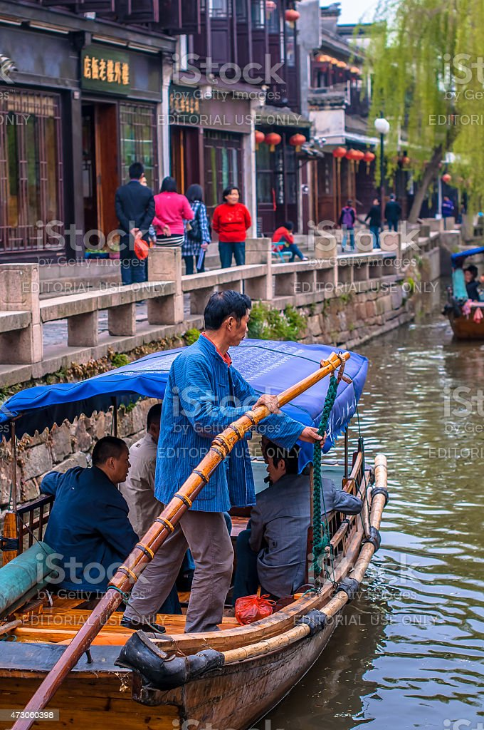 Boat on ancient canal stock photo