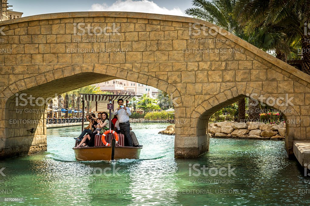 Boat on artificial lake of Madinat Jumeirah hotel in Dubai stock photo