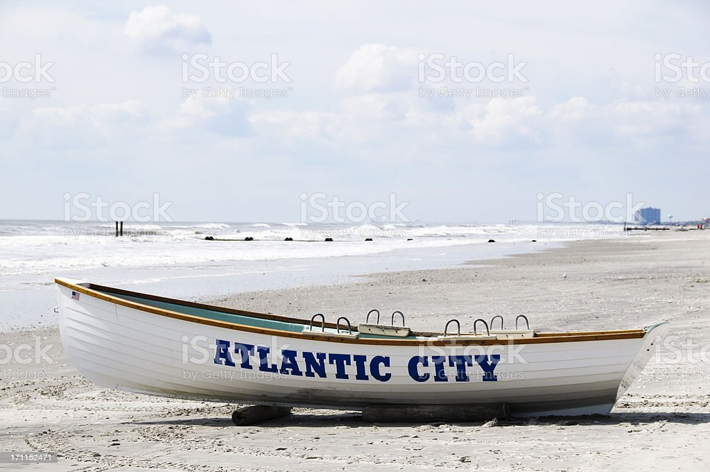 Boat on Atlantic City beach stock photo