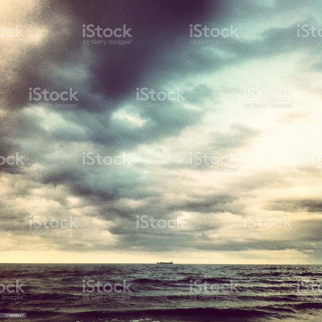 Boat on bad weather sea in northern germany royalty-free stock photo