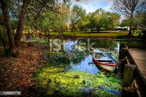 Boat on bayou of Vermillonville french acadien historical village Louisiana USA
