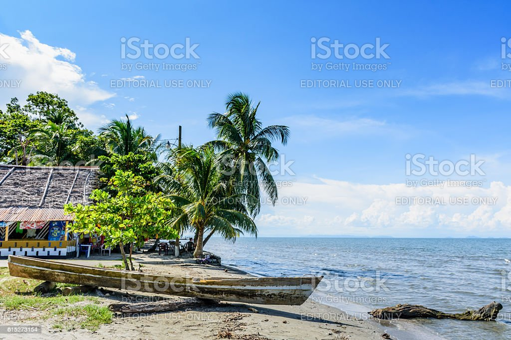 Boat on beach, Livingston, Guatemala stock photo