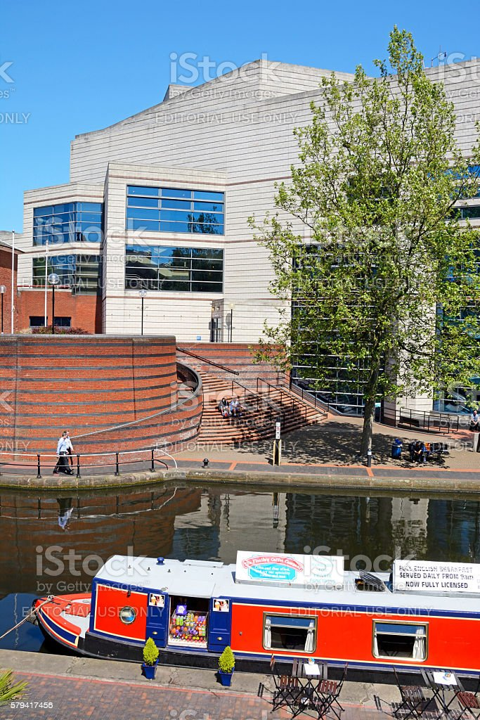 Boat on canal at rear of ICC, Birmingham. stock photo