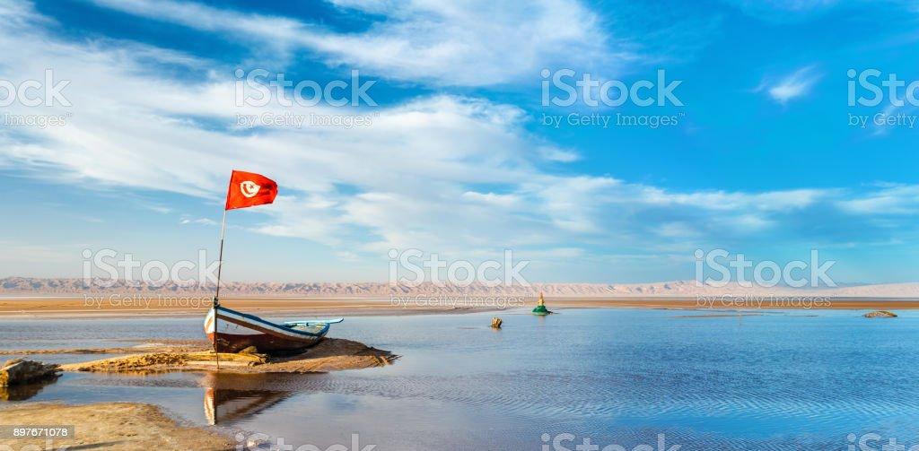 Boat on Chott el Djerid, a dry lake in Tunisia stock photo
