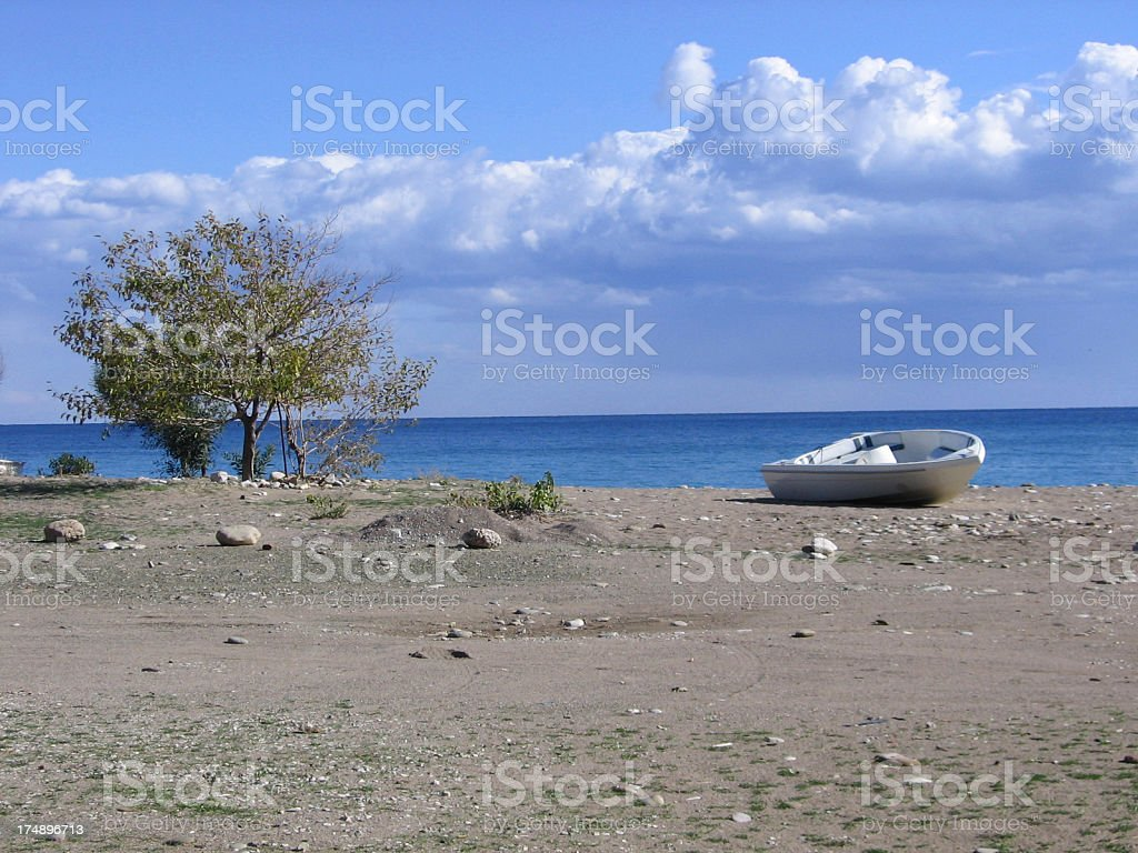 boat on deserted Beach royalty-free stock photo