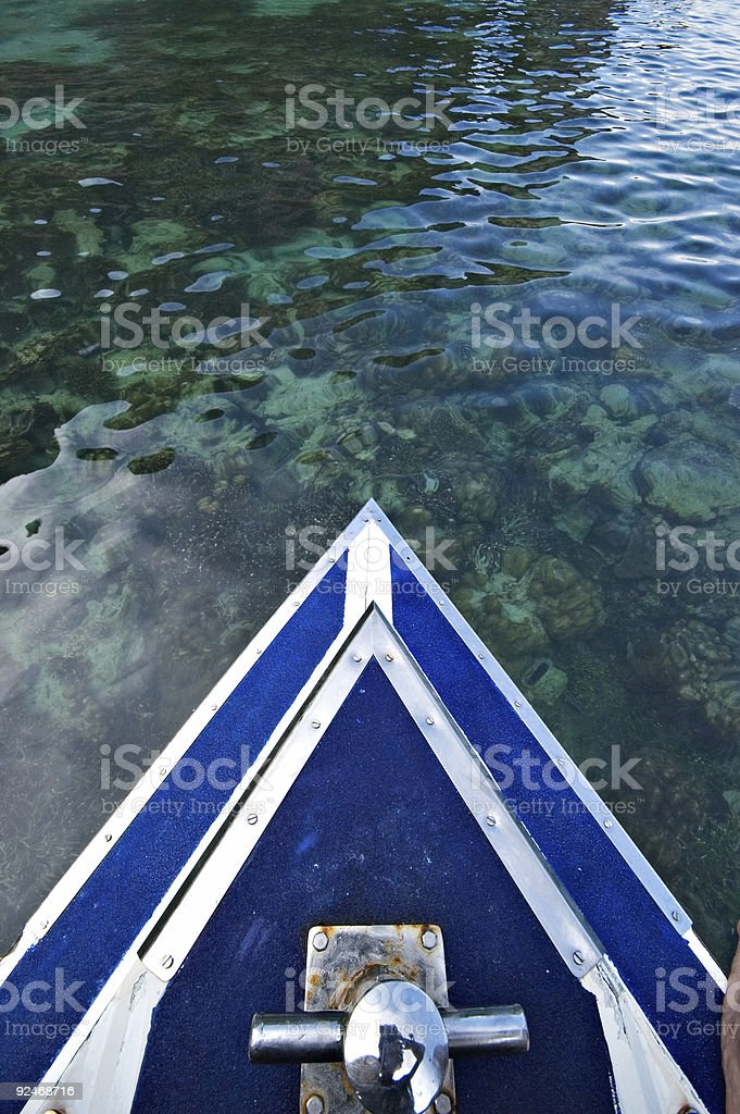 Boat on emerald waters of Phi Phi Island, Thailand royalty-free stock photo