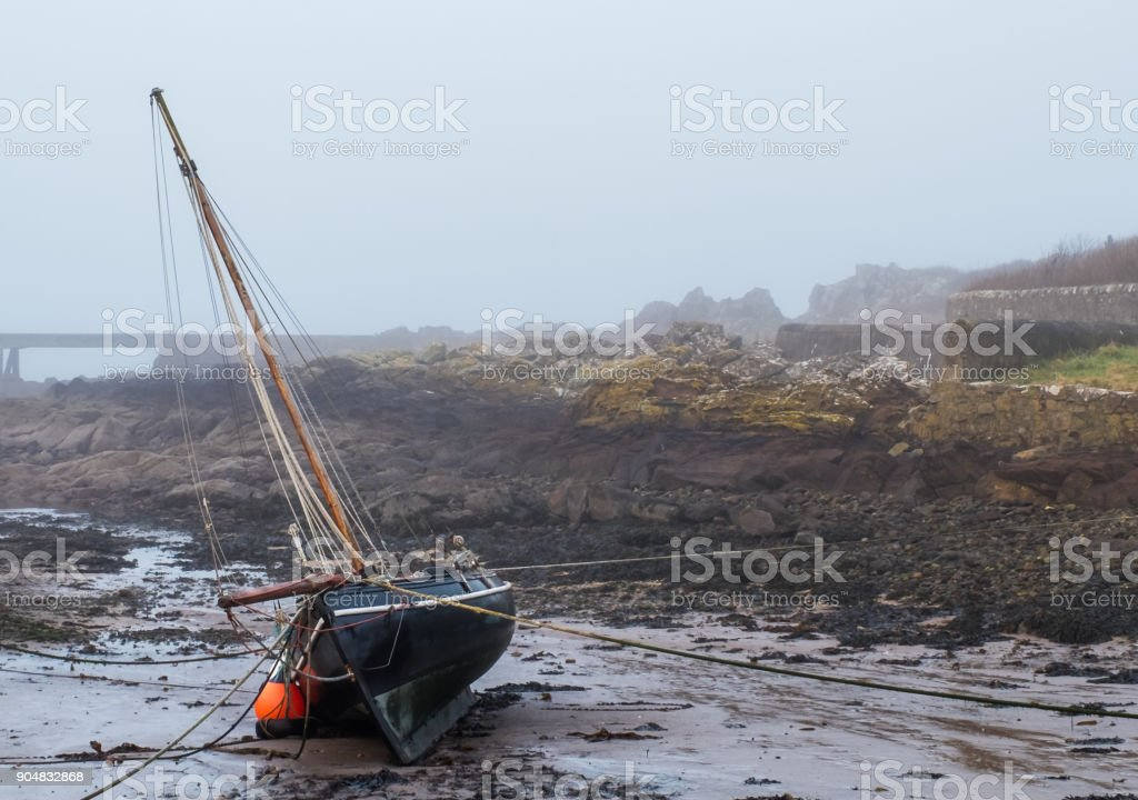 A boat on its side after the tide went out stock photo