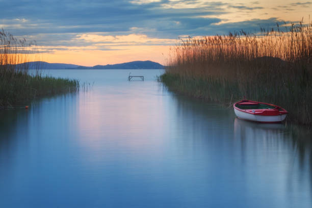 Boat on lake Balaton in the late evening with beautiful cloudy sky stock photo