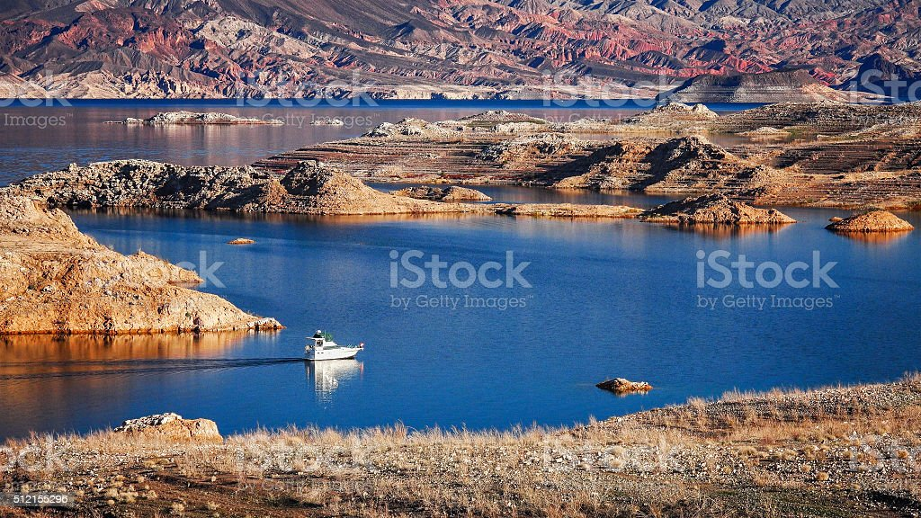 Boat on Lake Mead A boat enters a narrow channel on Lake Mead Blue Stock Photo
