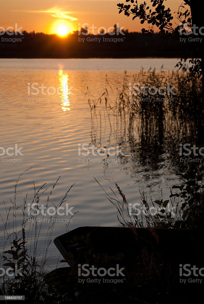 Boat on lakeside stock photo