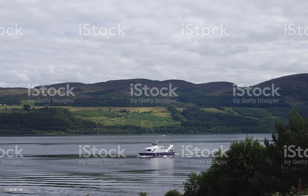 Boat on Loch Ness stock photo