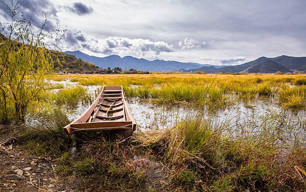 Boat on Lugu lake stock photo
