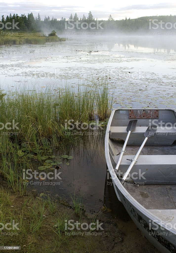 Boat on Misty Lake royalty-free stock photo