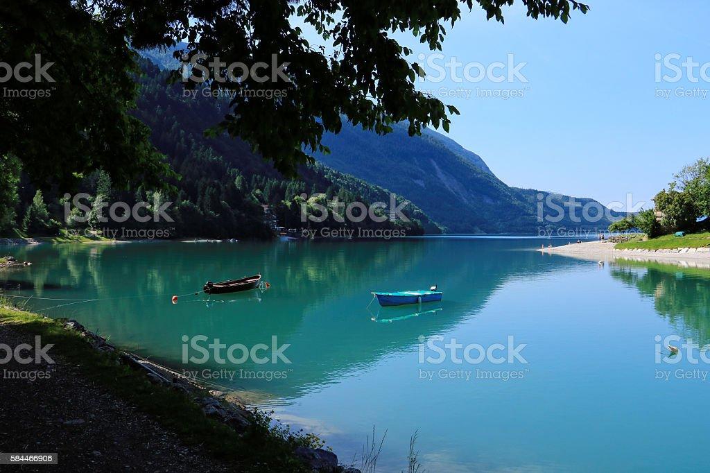 Boat on Molveno lake - beautiful morning stock photo