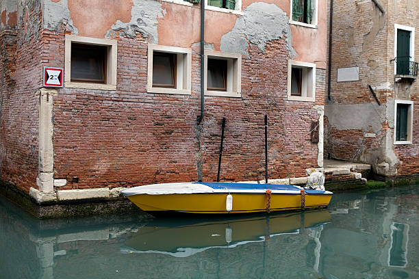 Boat on Quiet Canal Venice Italy stock photo