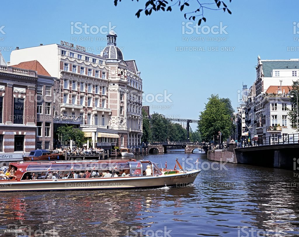 Boat on River Amstel, Amsterdam. stock photo