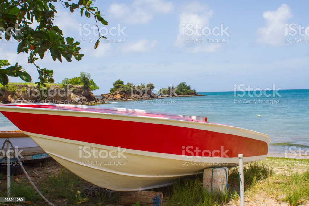 Boat on shore in Caribbean stock photo