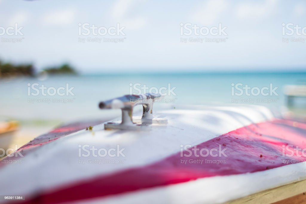 Boat on shore in front of island stock photo