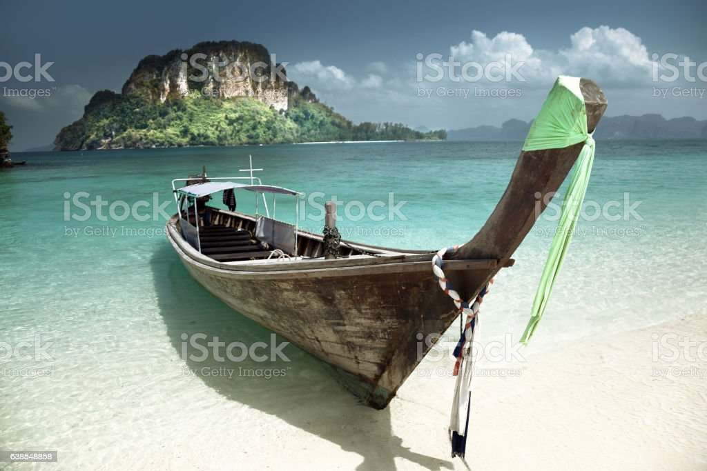 boat on small island in Thailand stock photo