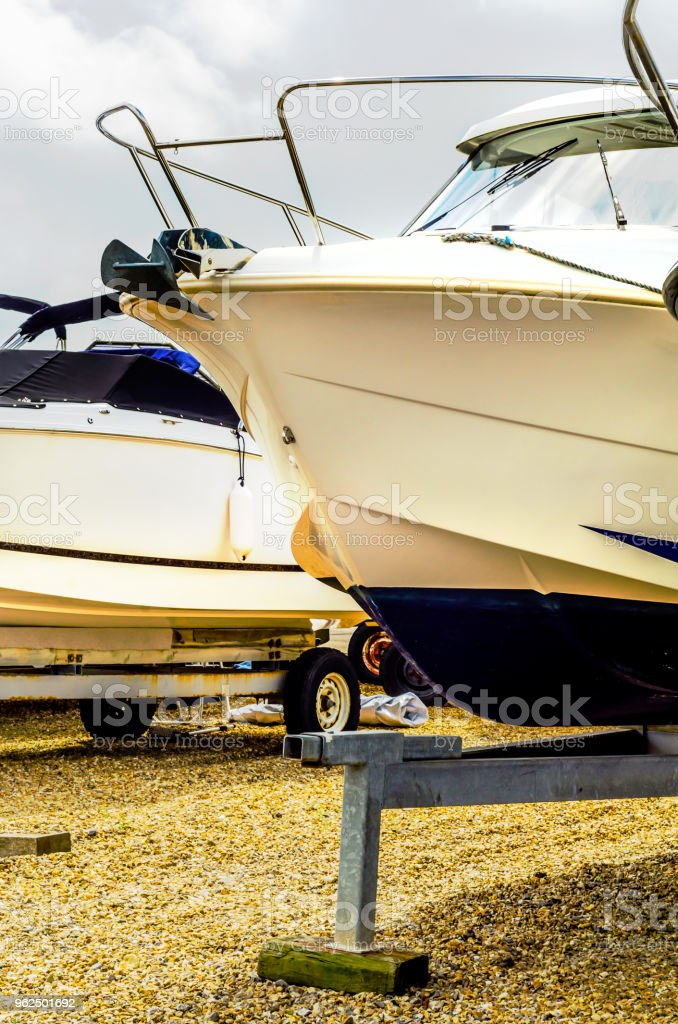 Boat on stand on the shore, close up on the part of the yacht, luxury ship, maintenance and parking place boat - Royalty-free Bowl Stock Photo