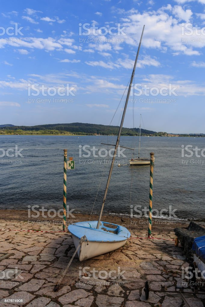 boat on the banks of the Arona Lake stock photo