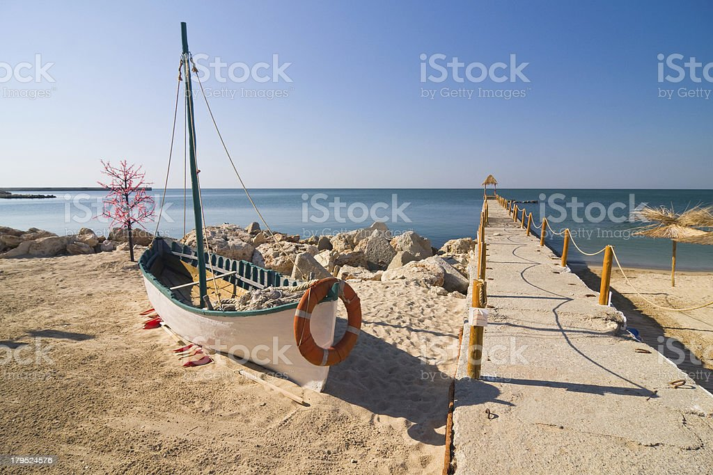 Boat on the beach at sunrise time stock photo