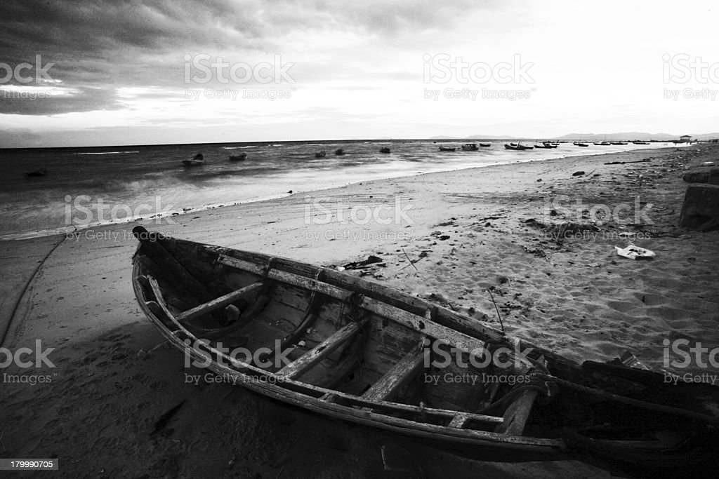 Boat on the beach black and white