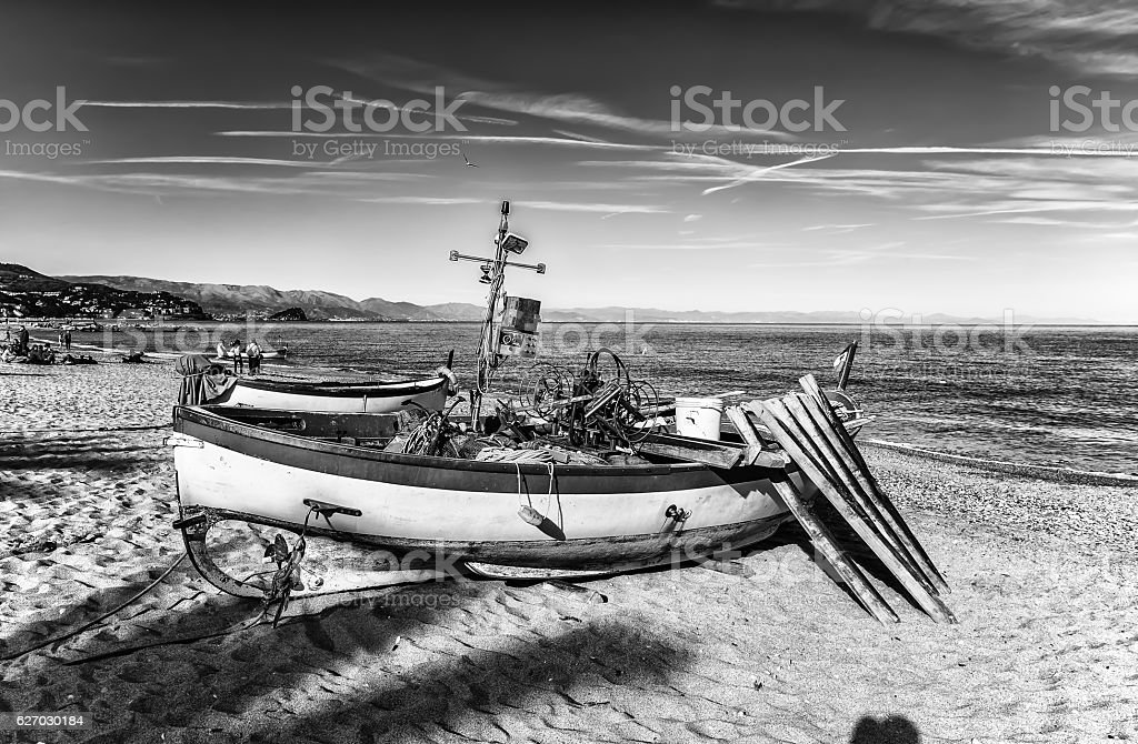 Boat on the beach/ sea/ water/ italy/ old stock photo